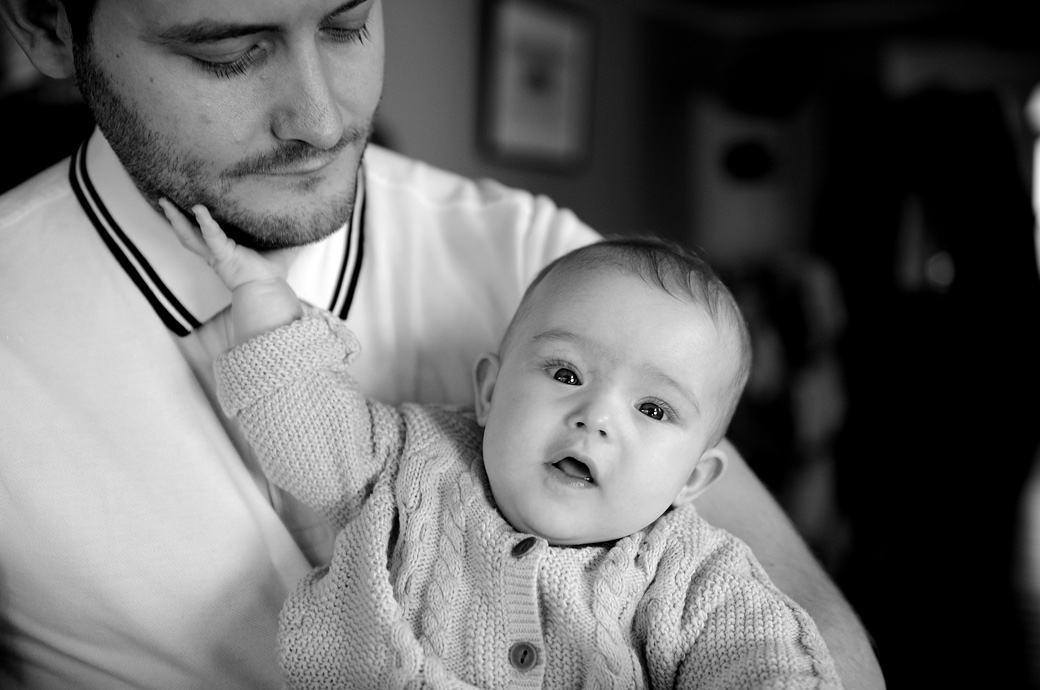 A baby portrait of a little daughter gently stroking her father's beard taken in Dulwich by a London portrait professional