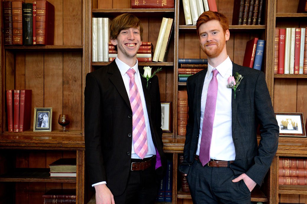 Smiling Groom and Best man captured in this wedding picture in the elegant Mayfair Room adjacent to the intimate Marylebone Room at London wedding venue Mayfair Library