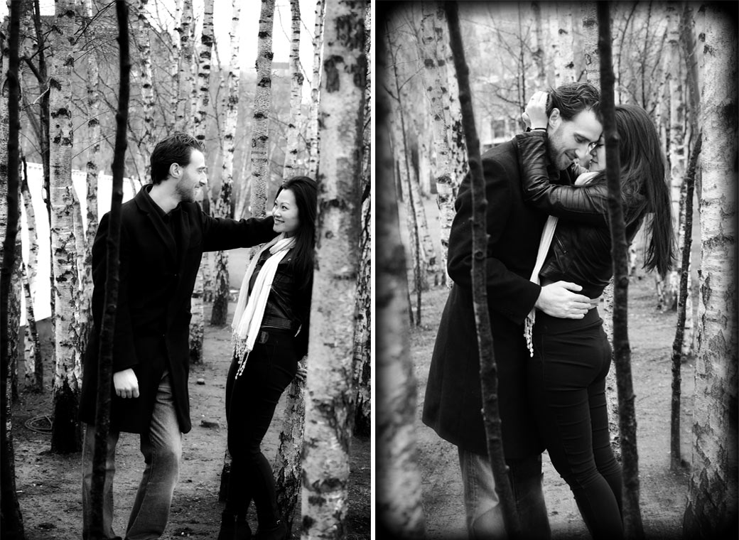 Pre wedding photographs of young lovers loving looks and embrace as they stand by a coppice of slender Silver Birch trees outside Tate Modern Bankside London