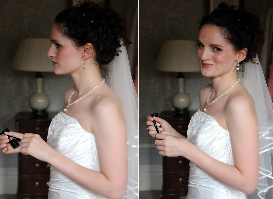Concentrating Bride turns round to smile at the London wedding photographer as she gets ready in this sweet wedding photograph taken at London wedding venue Cannizaro House
