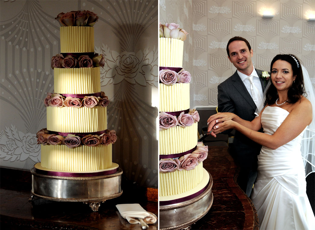 Happy newlyweds cut an impressive four tiered wedding cake in these wedding photographs taken at Cannizaro House, a fine London wedding venue situated on Wimbledon Common
