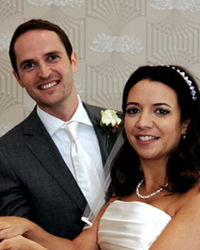 All smiling and happy newlyweds looking relaxed in this wedding photograph taken at a fine London wedding venue Cannizaro House, situated on Wimbledon Common