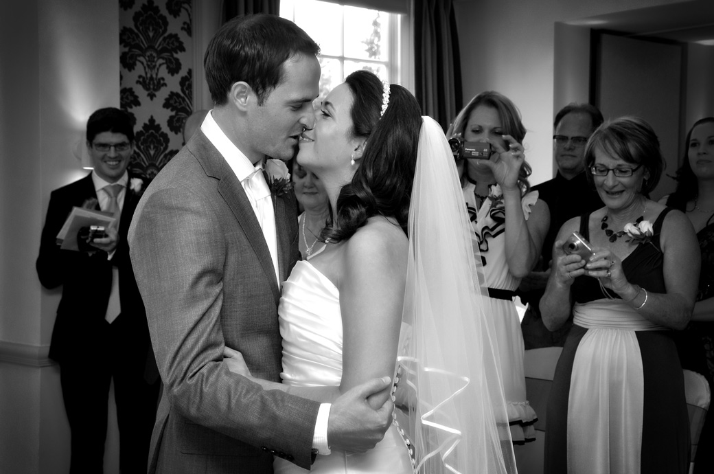 A passionate loving kiss wedding picture taken just after being pronounced husband and wife at boutique London wedding venue Cannizaro House