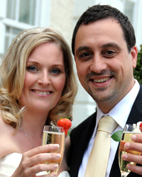 A happy and joyful newlywed couple captured in this wedding picture at London wedding venue Cannizaro House as they celebrate with a champagne toast