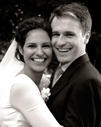 A happy smiling portrait wedding photograph taken outside the the Brompton Oratory a stunning Italian Renaissance style London wedding venue