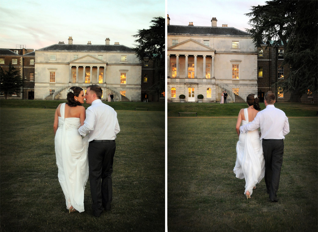 Couple canoodling and walking towards the magnificent Parkstead House at sunset wedding photos taken by London Lane wedding photographers in Roehampton