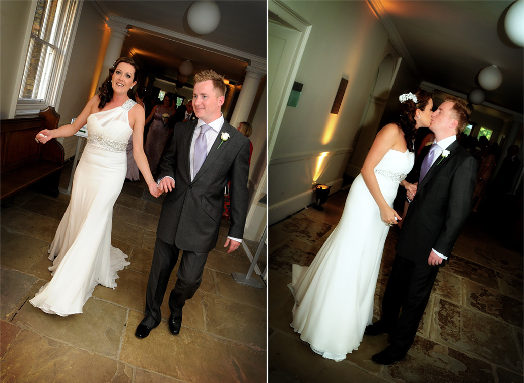 Happy and romantic newly-weds wedding pictures taken as they walk down the corridor from the Manressa Hall at Parkstead House by London Lane wedding photography