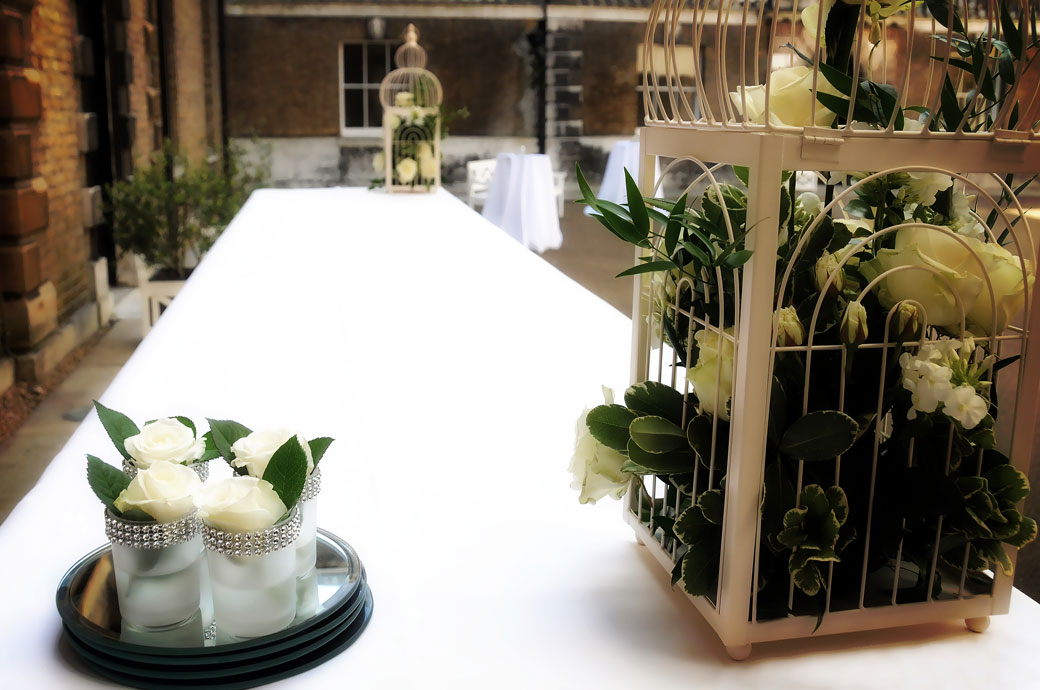 Evocative rose display wedding photos captured by London Lane wedding photography in the Victorian Courtyard at Parkstead House Roehampton