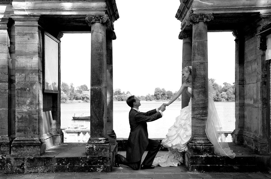 Kent wedding photographers capture this gallant and romantic Groom on his knees before his Bride in the Italian Garden at Hever Castle