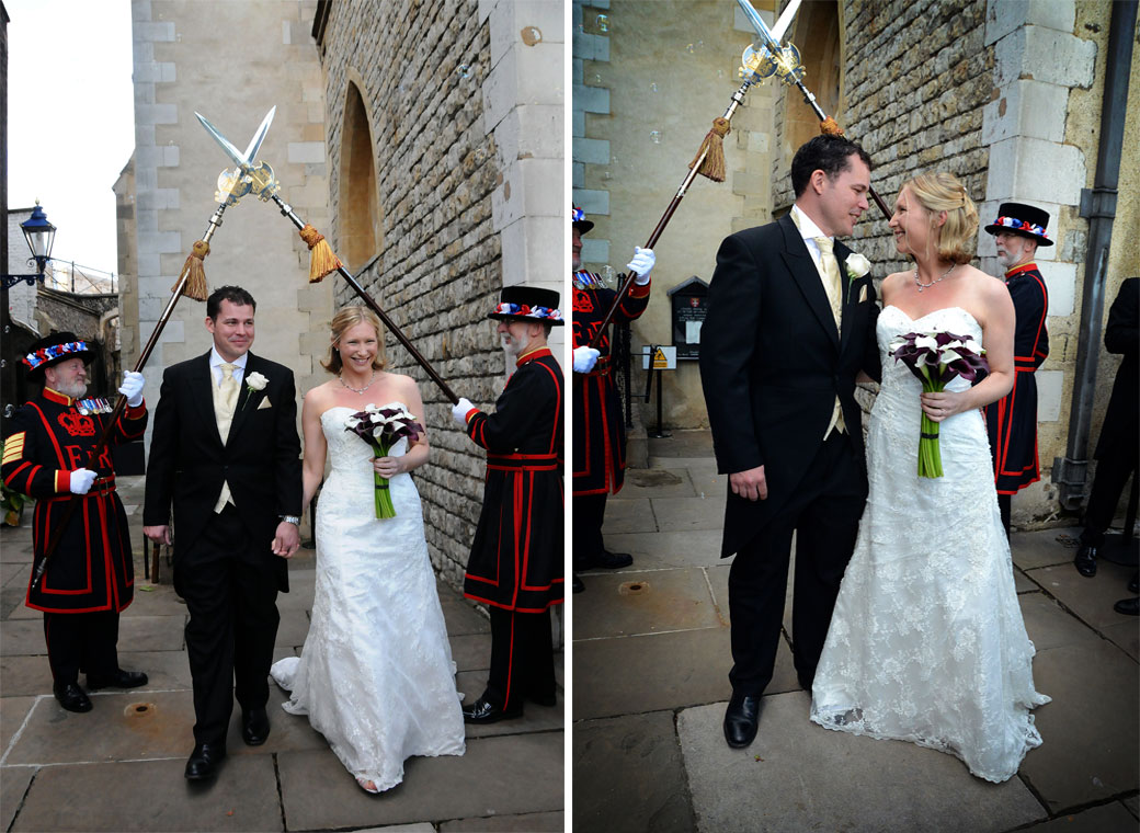 Two wonderful excited newly-wed wedding photos taken as they walk under the Beefeaters crossed spears taken at The Tower of London a truly unique London wedding venue