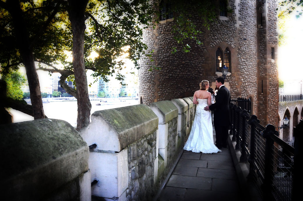 Romantic newly-weds on the  South Wall captured in this romantic wedding photograph at The Tower of London wedding venue