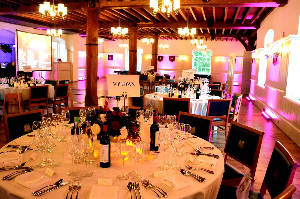 The Tower of London as a wedding venue offers the wonderful New Armouries banqueting suite captured here in this wedding picture all set up ready for the wedding breakfast guests