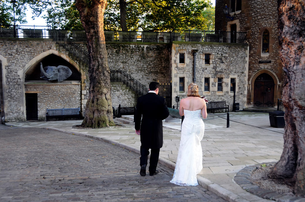 Unique walking towards the South Wall and an elephant wedding picture taken of the Bride and Groom at the magical and historical The Tower of London wedding venue